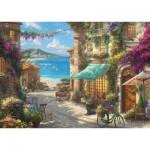Puzzle  Schmidt-Spiele-59624 Thomas Kinkade - Café by the Italian Riviera